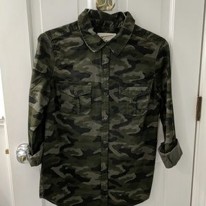 Camouflage snap front shirt.